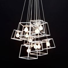 $2796.50  Fab.com  30% off!!  The geometric Frame lights are clustered into a big cloud of squares. This large, spectacular chandelier contains 11 lights, five medium and six small lights.