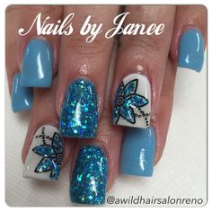 Blue glitter flower nails by Janee at A Wild Hair Salon Reno