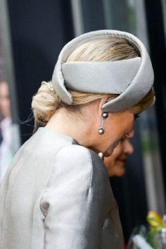 Queen Maxima of The Netherlands hat details during visits to De Hogeweyk in Weesp, The Netherlands, 4 April 2014