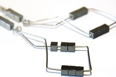 Metallic Geometrical Earrings #jewelry #681team http://www.etsy.com/treasury/MjA4OTExMTZ8MjcyMzM3OTM1OA/black-and-white