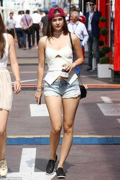 Leggy display: Victoria's Secret model Barbara, 22, opted for a casual look on the sweltering day and wore tiny denim hot pants with a white top