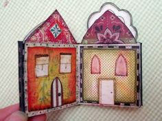 A little book of houses. Each of the four pages features a different style of house, front and back, so there are eight houses inside.