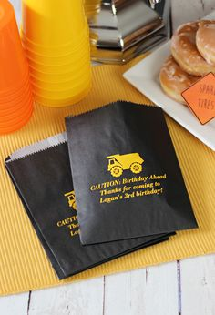 Send birthday guests home with candy from your buffet, a slice of cake, or other homemade treats these grease-resistant, wax-lined favor bags. Personalize with the theme of your choice for a boy or girls party. There are a huge selection of birthday designs and printing options like the cute construction theme shown.  Print with three lines of text to craft your own thank you message to friends and family.  To order, visit http://tippytoad.com/personalized-birthday-party-candy-favor-bags.asp