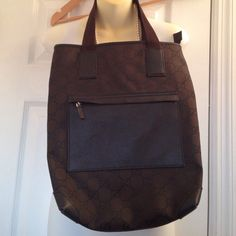 """AUTHENTIC Gucci Shoulder Bag 😡NO TRADES😡 AUTHENTIC ✅ Brown fabric and leather.  I've had this for a while used for my weekend wear.  I have since found other handbags to love and I have not use this in a while.  In great condition comes from a smoke free home.  One big zippered pocket, small zippered interior pocket and one outer pocket on the exterior.  Dark chocolate brown color.  13""""x16""""x5""""    See other listing for additional pictures. Gucci Bags Shoulder Bags"""
