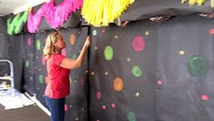 Great idea put up black paper and use glow I. The dark paint and have friends paint on wall