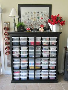 Great organizational ideas: the painted cans used for various spools of string (complete with handy scissors), and the magnetic tins holding little baubles hanging from the mirror.