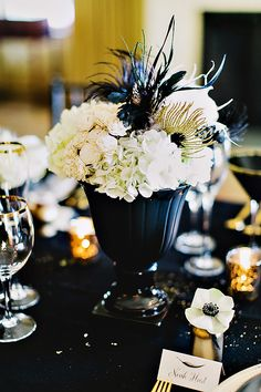black and gold feather centerpeices | gold jars paired with letterpress feather place cards gold black ...