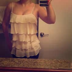 Cute Candies Ruffled Top  Super cute cream colored ruffled top from Candies. Never worn, in perfect condition. Would look great with skinny jeans and heels, perfect for a night out with the girls or date night. XS but fits like a junior size small.  Candie's Tops Blouses
