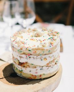 Each reception table at this wedding was set with treats (aka the dream)—including this Momofuku Milk Bar's birthday cake. The couple encouraged guests to dig in to the sweets before the meal even started.