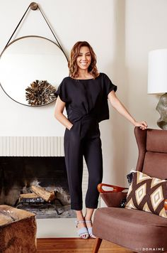 Michaela Conlin by her fireplace in the living room