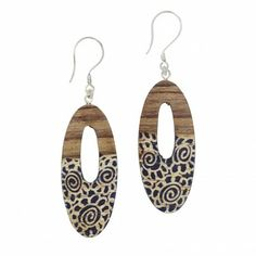 Batik Earrings Handmade in Indonesia  $24.00  Batik treatment gives these wood ovals an enchanting element. Batik painting on wood, like batik on fabric, is a centuries-old dyeing technique. First the artisan hand-traces and hand-paints an original design on the wood. Next, hot wax is applied where color is not required. The material is then dyed and the wax removed, leaving only the original design. Each color in a design represents a separate dyeing and waxing process.