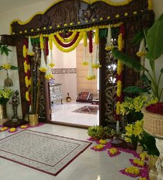 Navaratri pujas and homas invoke the ultimate primordial force Goddess Adi Shakti Indian Home Design, Temple Design For Home, Indian Home Interior, Interior And Exterior, Door Flower Decoration, Background Decoration, Home Entrance Decor, House Entrance, Main Entrance
