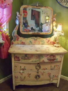 This dresser took me quite a while to complet, it is full of detail..hanging picture frames, hand applied barbola roses with a heavy seal coat for protection. Available for sale $875.00