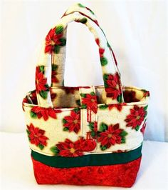 This listing is for a little girls Christmas Poinsettia purse handbag or tote bag.     The little girls purse features red poinsettias. The top features lots of poinsettias and the bottom is a sparkle red. the handles are interfaced to make them soft on little hands.  This little purse has 4 inside pockets for little treasures to hide in.   It has a button closure whcih is adjustable. Button it kooser as shown in the picture or tighter for less exposure from the top.   This little girls…