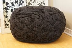 """Ravelry: Pouffe / Footstool / Ottoman Super Chunky Cable Knit 25"""" diameter x 16.5"""" high pattern by Erin Black"""