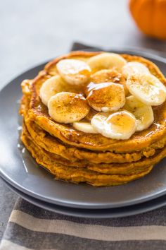 Lightened up healthy pumpkin banana pancakes are moist, fluffy, and delicious. They can be modified for paleo or gluten-free eaters too!  There's nothing better than a stack of warm and fluff…