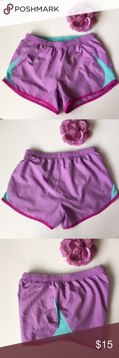 Nike Running Shorts Excellent condition, pristine. In fun lavender purple with fuschia trim and turquoise side panels. Thanks for shopping my closet! Nike Shorts