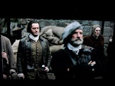Jamie's father, Black Brian, was indeed present at the flogging. He's just behind and to the left of Dougal, here. (The actor's name is Andrew Whipp.)