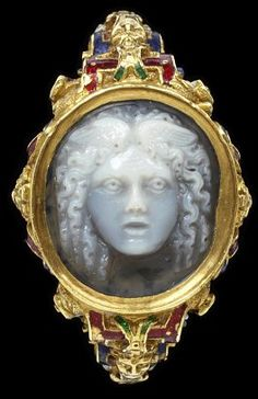 This ring of enamelled gold is set with an onyx cameo representing the head of Medusa. The shoulders and oval bezel are chased with cartouches, masks and foliage. The elaborate and colourful setting is typical of South German work around 1580.