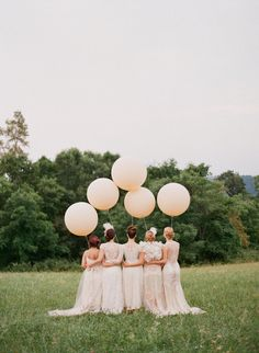 blush bridesmaids with balloons