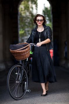 How someone in ballet flats with a wicker bike basket manages to look badass is beyond me, but she pulls it off.