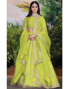 You can be assured to make a great style statement with this lime green thai silk lehenga. This lehenga is enhanced with embroidery work all over.Buy this latest designer lehenga choli online .Paired with matching choli and net dupatta Lehenga Choli Designs, Lehenga Choli Online, Lehenga Designs Latest, Sabyasachi Lehenga Bridal, Bollywood Lehenga, Bollywood Fashion, Alia Bhatt Lehenga, Silk Lehenga, Indian Wedding Outfits