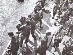 Le rôle des unités des Coast Guards fut important, ce sont eux qui ont effectué la majeure partie des transferts des troupes. England, juin 1944