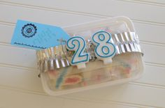 Cute way to wrap up birthday cookies in a care package-- candles glued to ribbon (Birthday Package)