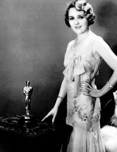 """Mary Pickford poses with her Best Actress Oscar for """"Coquette"""" 1928-29"""