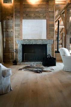 great fireplace idea. With the big black leather wood carry all of course. And fur rug.
