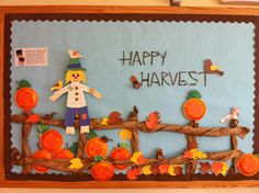 My Harvest time Bulletin Board for preschool.Harvest, bulletin board, pumpkins, scarecrow, fall