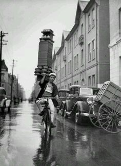 A delivery boy for a Tokyo Restaurant carries a tray of Soba...