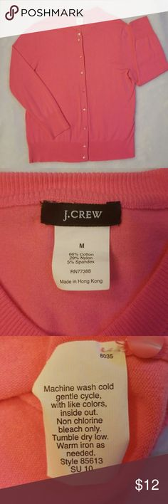 "Pretty J.Crew button up cardigan Button up cardigan from J.Crew in a beautiful coral/pink color in soft stretchy cotton. 3 quarter sleeves. 21"" from shoulder to hem and 18"" across bust. Looks great with a pretty necklace and cami underneath. Good condition with no holes, stains, rips, or pilling. J. Crew Sweaters"