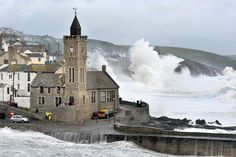 Waves crash on the harbour at Porthleven, Cornwall, as winds battered the UK. The Met Office issued weather warnings across south west England, the Midlands, the South East and Wales.