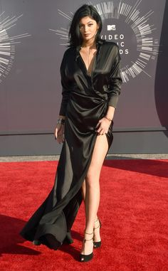Kylie Jenner at the 2014 MTV Video Music Awards. Kylie arrived showing some leg in a black wrap-style dress.