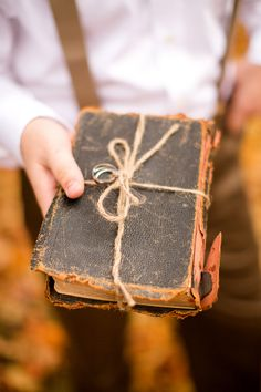 DIY barn wedding by Katelyn James Photography (19)  I have an old Bible of my uncle Davones that looks just like this... Great idea!