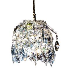 Crystal pendant is a re-interpretation of the traditional techniques of the craft. Inspired by the idea of an imploded chandelier, it consists of a dense mass of pure crystals. 5 kg.