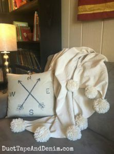 Just add pom poms to a drop cloth throw and you have a super fancy way to get cozy.
