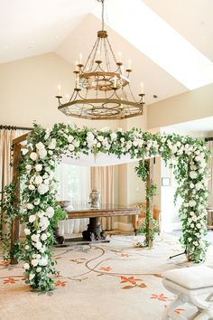 White floral wedding ceremony arch styled like a chuppah with greenery - Courtney Inghram Salamander Resort Middleburg Virginia Wedding Florist #ceremonyarch #weddingflowers #ceremonyideas #weddingchuppah #virginiaweddingflorist