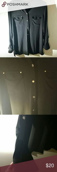 Black top with gold buttons 95% poly 5% spandex. Very soft. Sleeves can be cuffed with button on elbow. Bought for a work event but never wore. Dana Buchman Tops Button Down Shirts