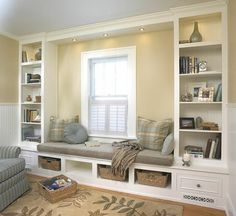 Window seat and built in shelving system. I love the idea of having a reading bench beside a window