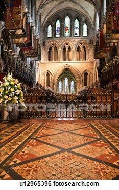 Stock Images of Interior view of central nave, with beautifully decorated pavement floor, looking towards altar and choir stalls, Romanesque ceiling and chapel walls, St. Patrick's Cathedral, Dublin, Southern Ireland u12965396 - Search Stock Photography, Poster Photos, Pictures, and Photo Clip Art - u12965396.jpg