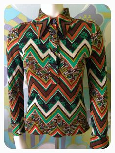 Items similar to Vintage Psychedelic Floral Orange Brown Green Big Pointy Collar Shirt Size S on Etsy Psychedelic, Etsy Shop, Trending Outfits, Unique Jewelry, Floral, Shopping, Orange, Vintage, Tops