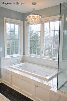 Master Bath, marble tile, SW Rain, crystal chandelier, tile that looks like hardwood, wainscoting tub
