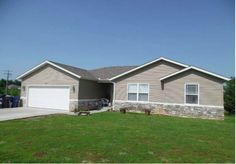 Beautiful 3 bedroom, 2 bath home in Webb City subdivision. This home offers an eat-in kitchen and additional dining area,  2 car attached garage and a 13x12 wood deck. An additional 1400+ square feet of unfinished walk-out basement space, with plumbing for bath, offers plenty of room to grow!  Only $148,700.  Call Rhonda 417-622-2850