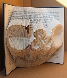 handgefaltetes Buch Schriftzug C&O