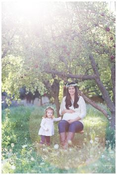 apple orchard, family photograpy, family poses, family of three, maternity pictures, mommy daughter maternity, orchard family pictures, flower crown, flower crown maternity, fall family pictures, little girl flower crown, swing, swooning swing