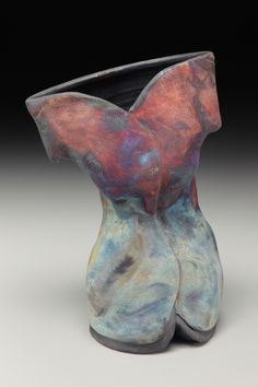 Raku fired 'thrown sculpture'.  Female figure.  Wheel thrown, and altered.