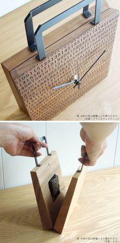 clock54 | 本物の紙バッグの様に、中が開いてムーブメントが内蔵されています。どこから見ても美しい、カバン型の時計。