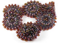 I dont know if its a self-selecting group, but every time I teach this class, it seems that the participants really get a kick out of it. The circles and colour-play are quite addictive!    The instructions show you how to make flat peyote circles using mostly size 8 seeds (use size 6 around the edges), and then join them together to make a few bracelets or a choker-length necklace. You also get to make a matching button for a seamless closure.This project is excellent for developing both an…